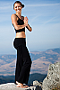 Lotus yoga pants - flared-leg - attached skirt - black - back view - Island Importer